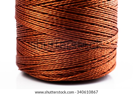 strong thick Nylon thread on a white background - stock photo