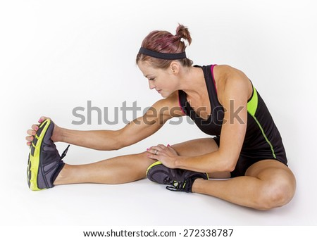Strong toned and muscular female stretching before her workout. Beautiful woman Isolated on a white background - stock photo