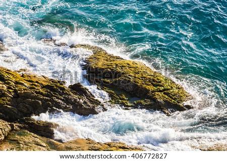 Strong wave of the sea impact near the coast - stock photo