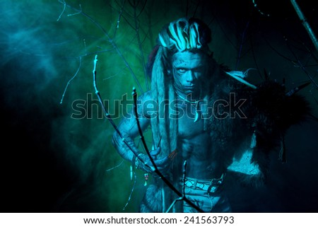 Strong werewolf, demon among the trees in the fog. - stock photo