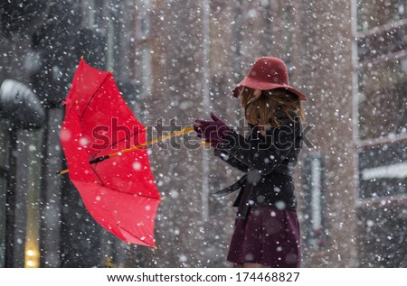 Strong wind try torn from the hands umbrella - stock photo