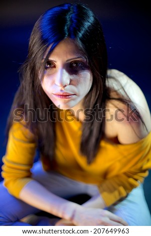 Strong woman depressed about violence - stock photo
