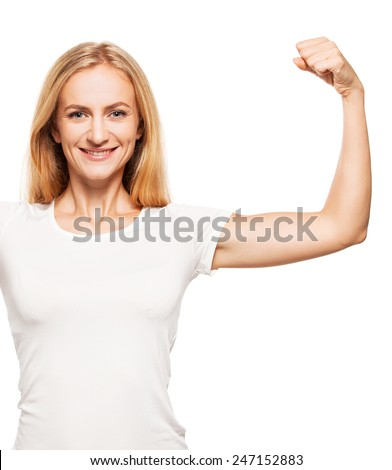 Strong woman. Female showing biceps - stock photo