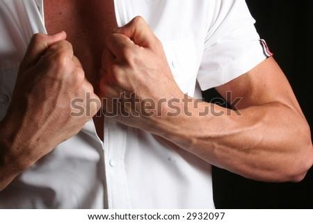 strong young  man ready to undress - stock photo