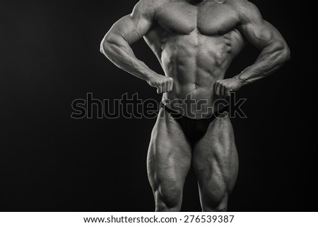 Strongman on a black background. Muscled. - stock photo