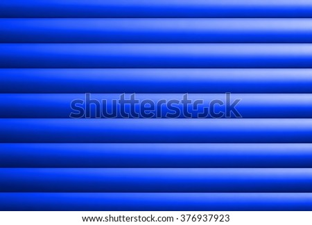 structure of a blue garage door made of aluminum - stock photo
