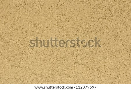 Structure of a yellow wall - stock photo