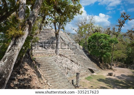 Structures of Western court at Copan archaeological site of Maya civilization in Honduras, important Altar Q is seen in the right lower corner - stock photo