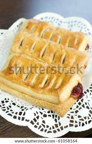 Strudel with fruit on a plate with selective focus and vertical view - stock photo