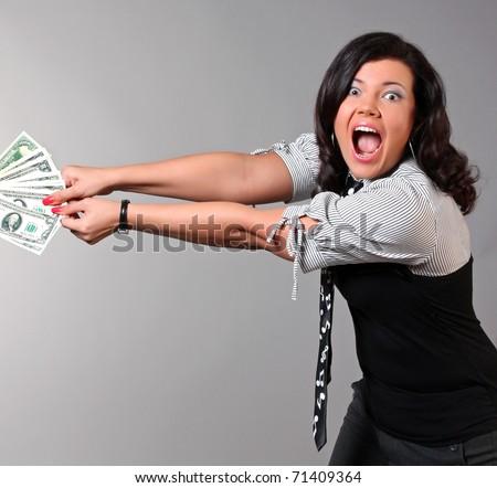 Struggling to keep money - stock photo