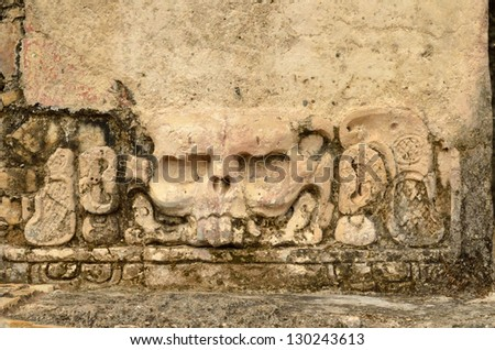 stucco famous skull with eye sockets in the ancient city of Palenque in Mexico. - stock photo