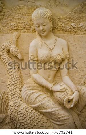 Stucco Traditional Thai Thai women. - stock photo
