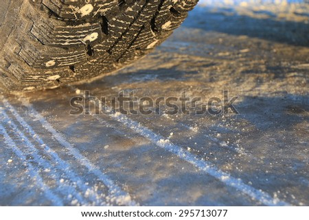 studded tire wheel winter ice slippery - stock photo