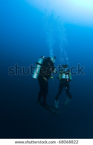 Student and Instructor during a underwater Scuba lesson - stock photo