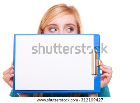 Student blank banner sign. Blonde girl female college student holding and hiding behind clipboard with empty blank copy space for text. Isolated on white background - stock photo