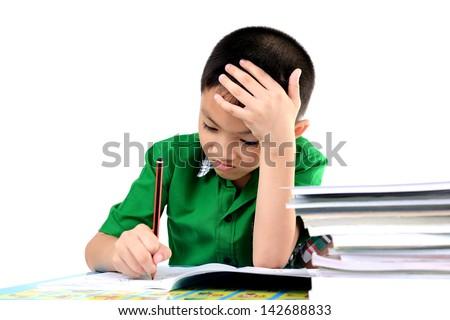 Student boy tired to do homework - stock photo