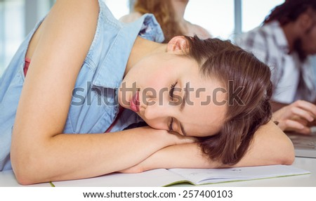 Student dozing during a class at the college - stock photo