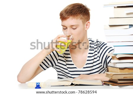 Student drink diet supplement while learning - stock photo