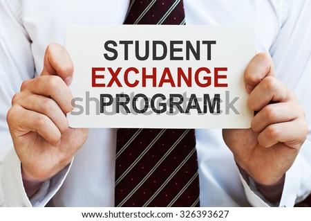 Student Exchange Program card in male hands - stock photo