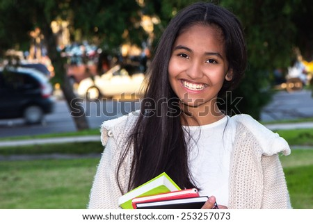 Student girl outdoor smiling happy - stock photo
