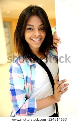 Student girl standing in college building - stock photo