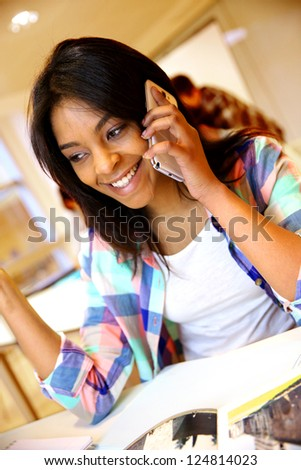 Student girl using smartphone in class - stock photo