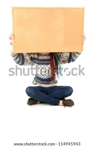 student girl with blank cork board, full length, white background - stock photo