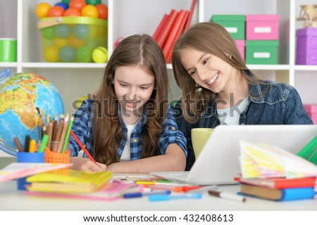 student girls at class with laptop  - stock photo