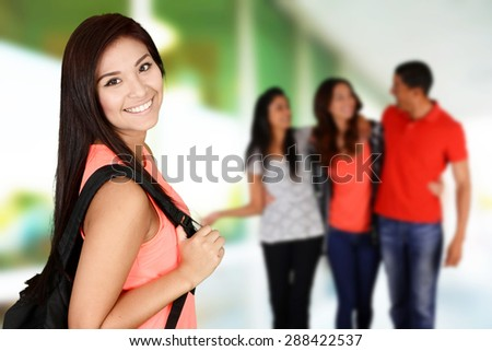 Student going to class at her college - stock photo