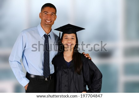 Student graduating standing by her teacher at school - stock photo