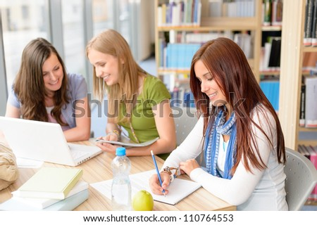 Student group working on computer at study room high school - stock photo