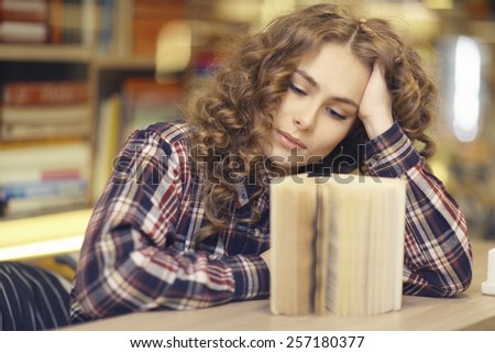 student in a library portrait - stock photo