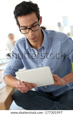 Student in class using digital tablet - stock photo