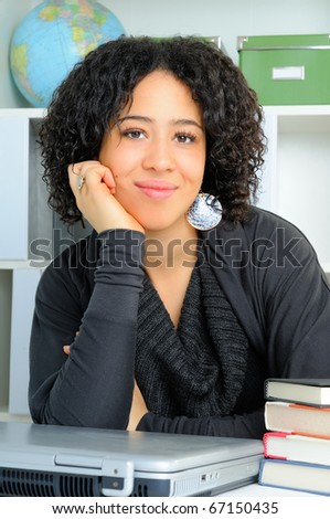 Student In College Sat At Her Desk In Class leaning On Her Arm - stock photo