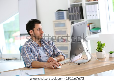 Student in web-design working in office - stock photo