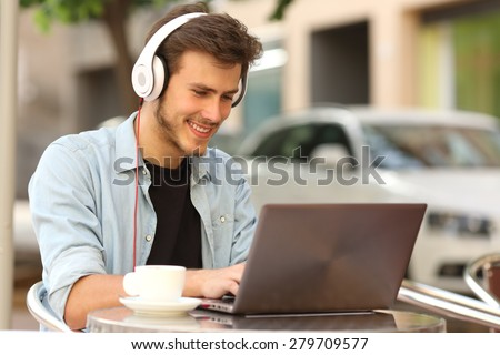 Student learning or entrepreneur working with a laptop in a bar terrace - stock photo