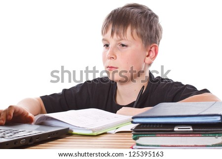 student lessons taught at a school desk - stock photo