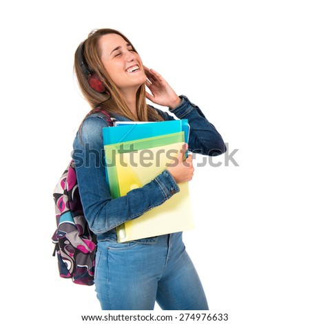 Student listening music over white background - stock photo
