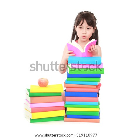 Student little asian girl reading the book - stock photo