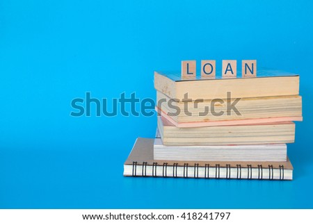 Student loan , Scholarship fund,stack of textbooks - stock photo