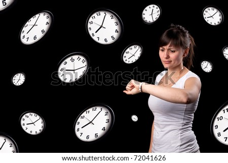 Student looking watch with surprised expression - stock photo