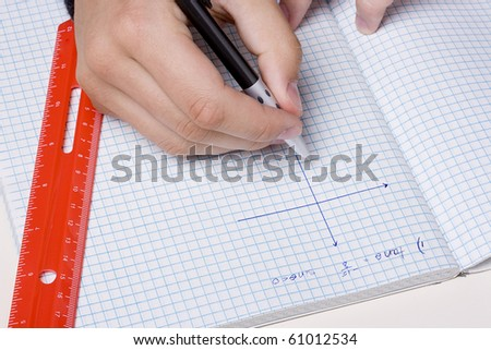 Student making a graph to solve a mathematical problem. - stock photo