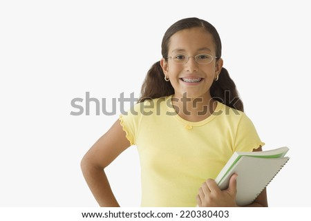 Student posing for the camera with books - stock photo