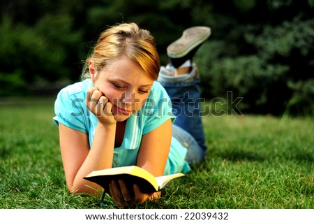Student Reading in a public park - stock photo