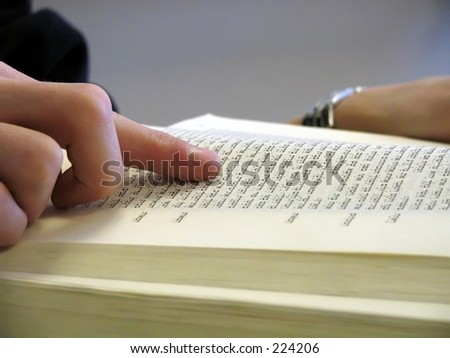 student reading the bible - stock photo