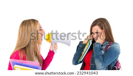 Student shouting at her friends over white background - stock photo