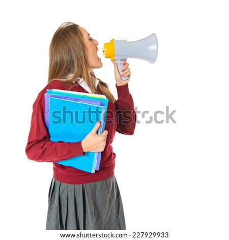 Student shouting by megaphone over white background  - stock photo