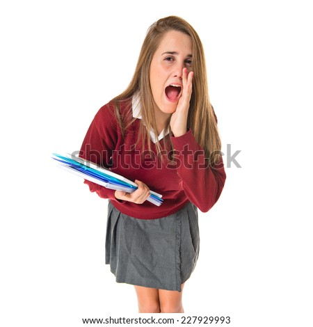 Student shouting over isolated white background  - stock photo