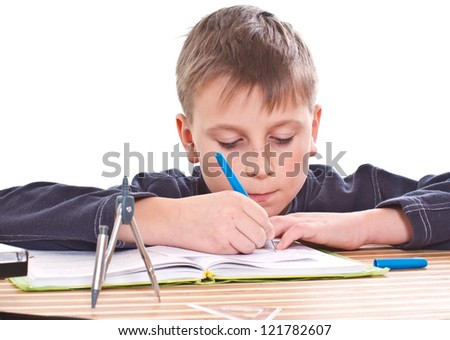 student to do homework at a table on a white background - stock photo
