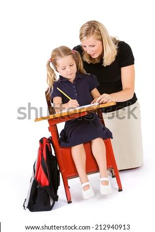Student: Tutor Or Teacher Kneels Down To Help Student - stock photo